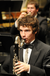 concert photo of a bass clarinetist performing