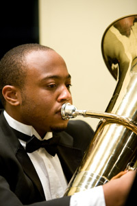 photo of student performing on tuba